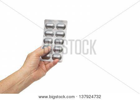 Old female hand holding a drug package - Drug and medicine usage for the elderly concept