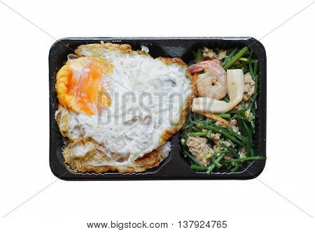 Takeaway food. Fried rice with vegetable and fried egg in microwavable container