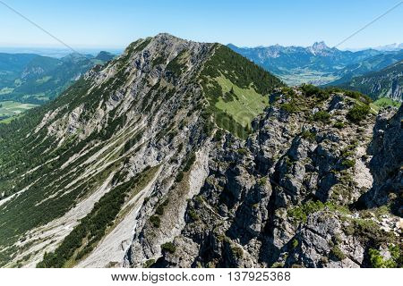 Iseler Mountain with wild rocky cliff. The Iseler is a tall mountain close to the Oberjoch Valley and the village Bad Hindeland in Bavaria, Germany