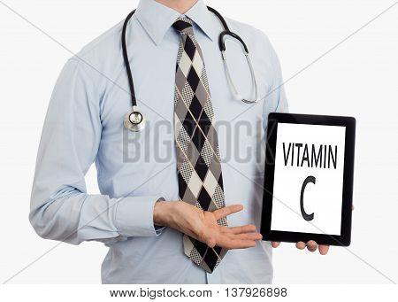 Doctor Holding Tablet - Vitamin C