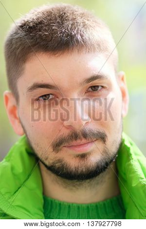 Man in green outdoor portrait
