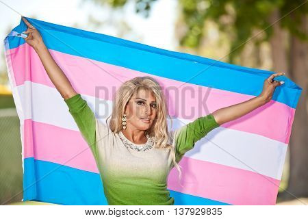 Male to female holding Transgender flag proud