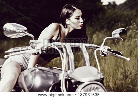Beautiful Young Woman Posing With A Motorcycle
