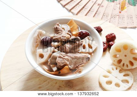 Chinese traditional Pork rib soup with Lotus root, dried squid,peanut and red dates