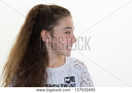 Girl Smiling And Looking At The Camera Isolated On White