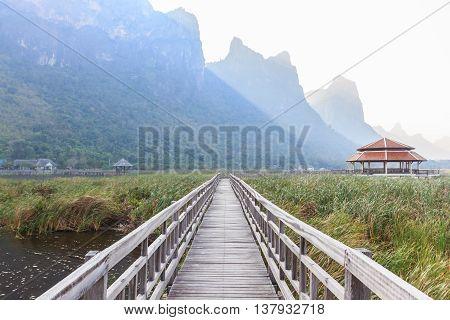 Wooden Bridge in lotus lake at Khao sam roi yod national park Prachuap Khiri Khan Thailand.