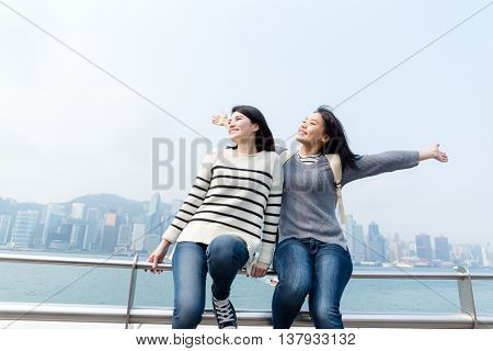 Excited woman enjoy travel in Hong Kong