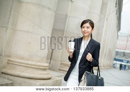 Young business woman walking outside