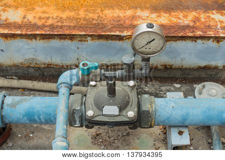 Dial gauge and relief valve connection for pumping station.