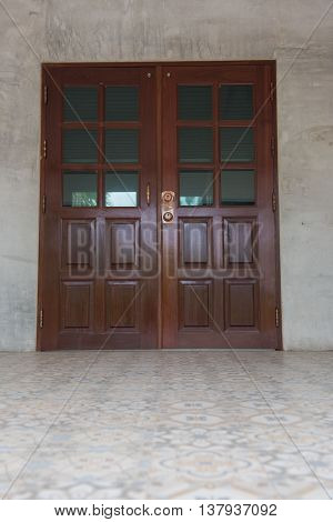 Double doors brown wooden closed off the house.