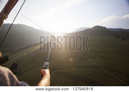 Paraglider taking selfies while flying