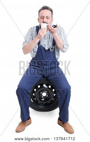 Young Mechanic Relaxing And Enjoying Fresh Coffee