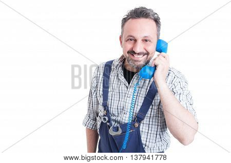 Happy Handsome  Mechanic Talking On Vintage Telephone