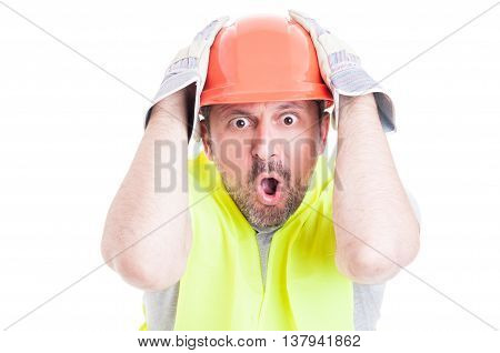 Shocked Young Builder Holding His Head Looking Desperate