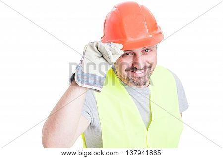 Portrait Of Cheerful Constructor Doing A Salutation Gesture