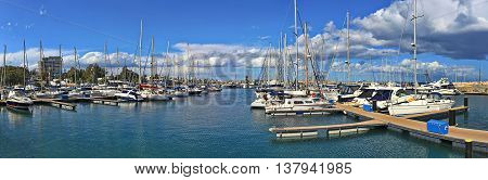CYPRUS, LARNACA - MARCH 14, 2016: The numerous fishing boats, tourist ships and luxury yachts moored in Larnaca marina, Cyprus.