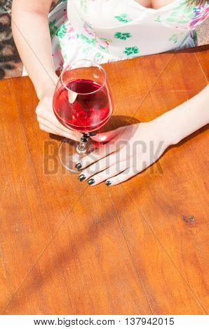 Glass Of Wine On Wooden Terrace Table