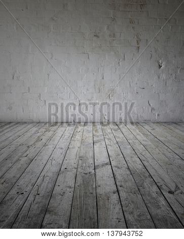 Wooden floorboards and brick wall