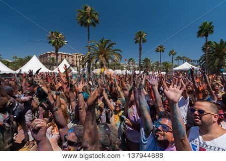 BARCELONA, SPAIN - JULY 9 2014:People put hands in a air at Holi festival at Escenario del Moll de la Fusta.