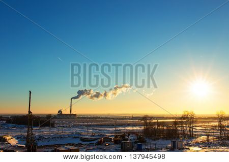 Dawn landscape with thermal power plant, winter time.