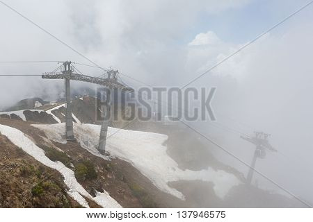Cableway in the mountains during heavy fog