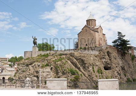 TBILISI, GEORGIA - 7 AUGUST,2013:Virgin Mary Metekhi church with Vakhtang I Gorgasali statue in Tbilisi, Georgia