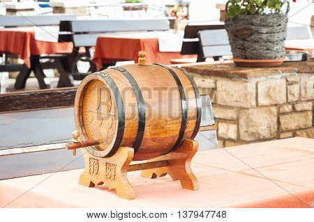 Small barrel of wine on table of restaurant