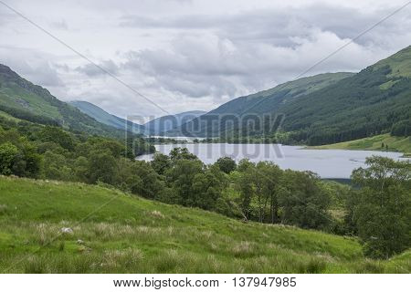 Looking along Loch Doine to Loch Voil with forested hills and valleys of Scotland.