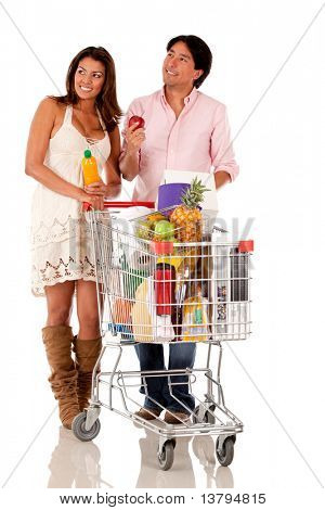 Couple with a shopping cart looking for groceries - isolated