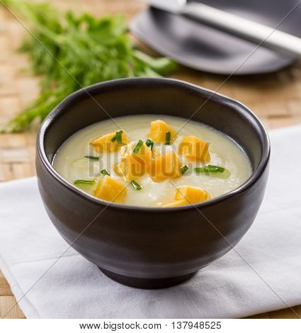 A bowl of fennel cream soup with cheddar cheese