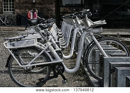 COPENHAGEN DENMARK - JUNE 23: Bicycles ready for renting in the city center on June 23 2016 in Copenhagen Denmark.