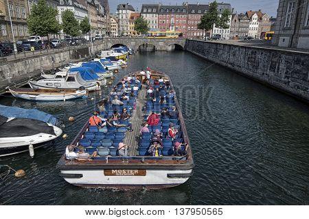 COPENHAGEN DENMARK - JUNE 23: Tour boat in Frederiksholm Canal - View from Marble Bridge June 23 2016 Copenhagen Denmark.