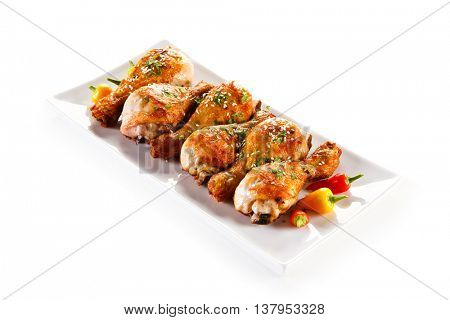 Roast chicken drumsticks and vegetables
