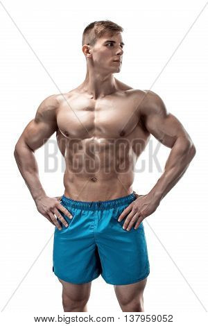 Strong Athletic Man showing muscular body and sixpack abs isolated on white background