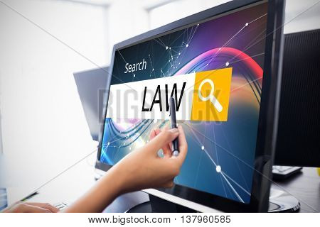 Logo of a search bar in which LAW is written against casual businesswoman touching her computer Casual businesswoman touching her computer with a pen