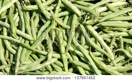 green beans on the counter market for sale as background.