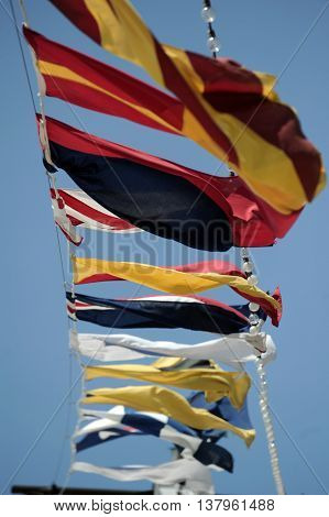 Maritime flags flying on the deck of a cruise ship