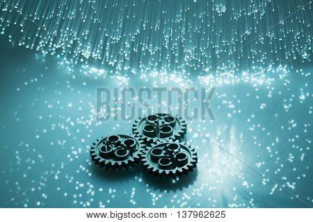 Fiber optics and gear High tech technology color background