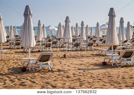 Umbrellas and beach chairs on empty beach. Turkey, Alanya.