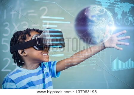 Earth globe against school boy in virtual reality glasses in classroom
