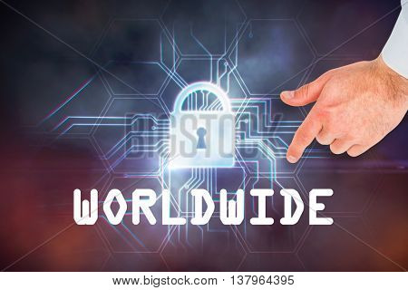 Businessman touching invisible screen against circuit board and lock graphic