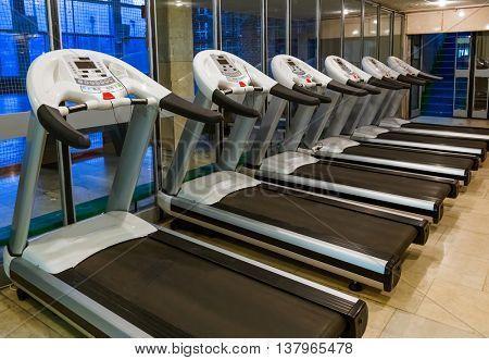 Gym in fitness club - sport background