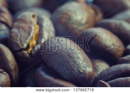 Coffee beans closeup can be used as the background. Macro.