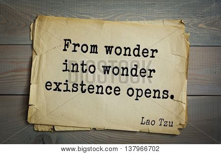 Ancient chinese philosopher Lao Tzu quote on old paper background.  From wonder into wonder existence opens.