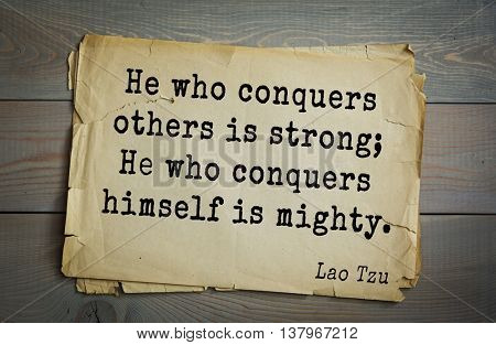 Ancient chinese philosopher Lao Tzu quote on old paper background.  He who conquers others is strong; He who conquers himself is mighty.