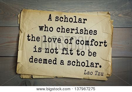 Ancient chinese philosopher Lao Tzu quote on old paper background.  A scholar who cherishes the love of comfort is not fit to be deemed a scholar.