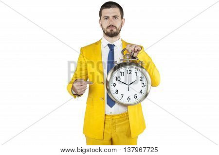 Focused Businessman Pointing At The Clock