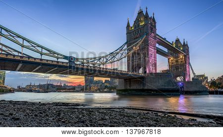 The Tower Bridge in London at sunset, seen from below