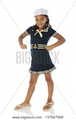 A pretty young sailor girl smiling at the viewer with a