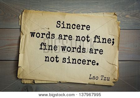 Ancient chinese philosopher Lao Tzu quote on old paper background. Sincere words are not fine; fine words are not sincere.